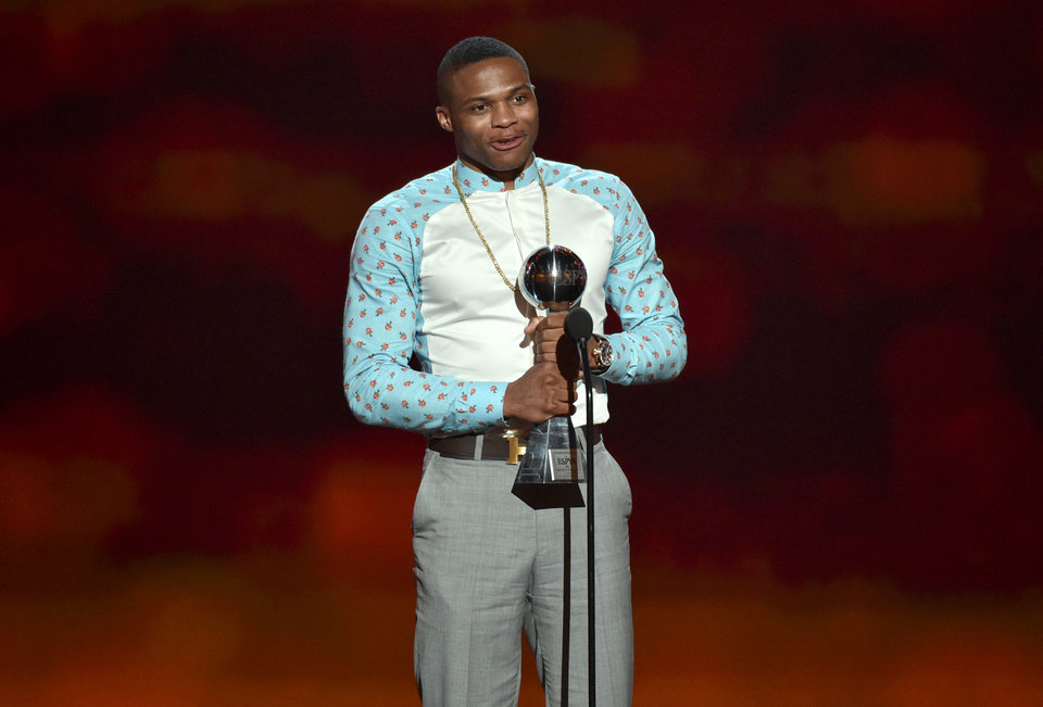Photo - Russell Westbrook accepts the award for best comeback athlete at the ESPY Awards at the Nokia Theatre on Wednesday, July 16, 2014, in Los Angeles. (Photo by John Shearer/Invision/AP)