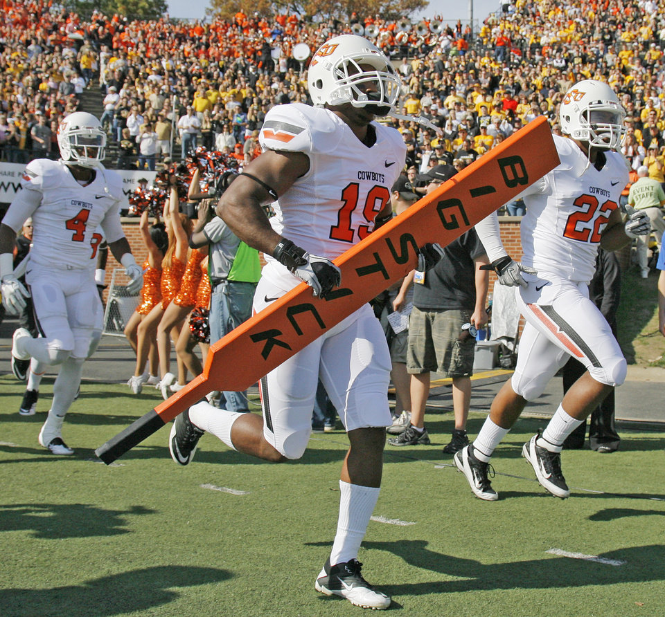 Photo - Oklahoma State's Brodrick Brown (19) carries the