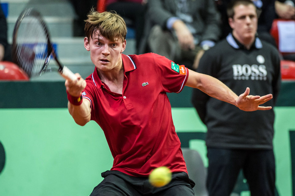 Photo - Belgium's David Goffin returns the ball during the Davis Cup World Group first round match against Serbia's Viktor Troicki at the Spriroudome in Charleroi, Belgium, Friday Feb. 1, 2013. (AP Photo/Geert Vanden Wijngaert)
