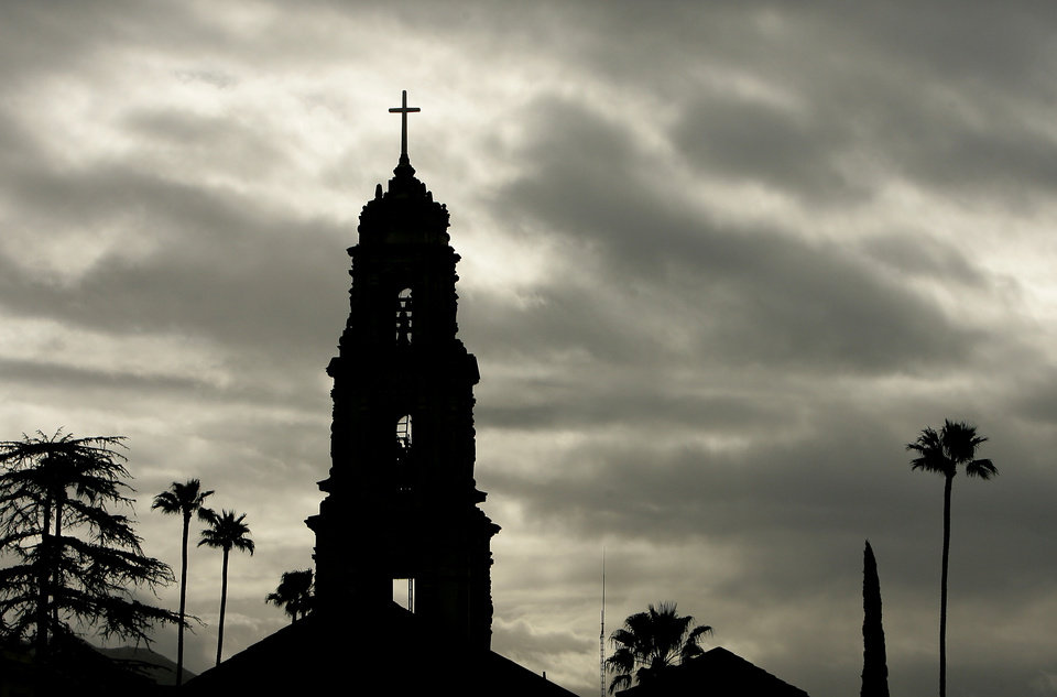 Photo - The bell tower at First Congregational Church in downtown Riverside, Calif. is silhouetted against cloudy skies on Saturday, March 1, 2014. A powerful Pacific storm hit the state early Saturday, but did not put a major dent in a drought that is among the worst in recent California history. (AP Photo/The Press-Enterprise, Stan Lim) MANDATORY CREDIT: THE PRESS-ENTERPRISE, STAN LIM