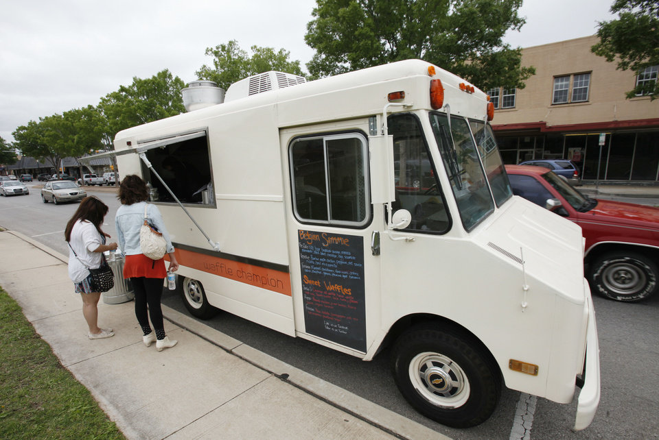 Photo - Waffle Champion, a mobile kitchen, serves sweet and savory waffles made to order.  David McDaniel - The Oklahoman