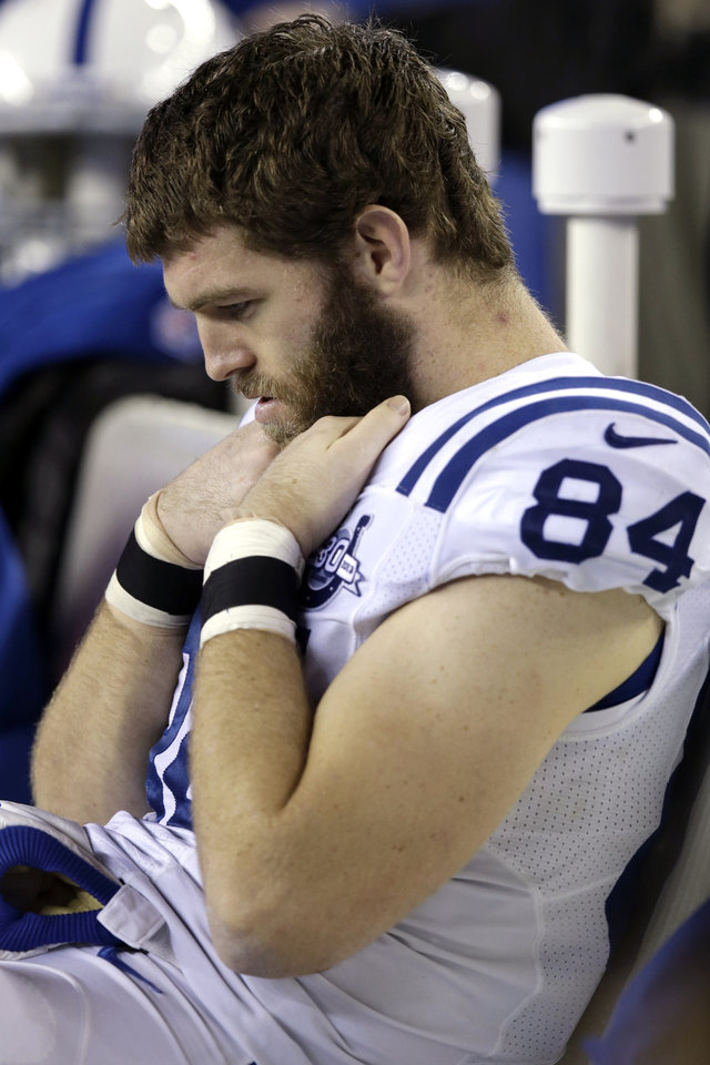 Photo - Indianapolis Colts tight end Jack Doyle sits on the bench during the closing minutes of the second half of an AFC divisional NFL playoff football game against the New England Patriots in Foxborough, Mass., Saturday, Jan. 11, 2014. (AP Photo/Stephan Savoia)