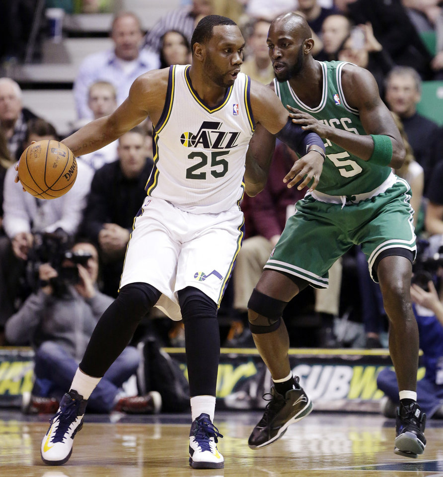 Boston Celtics' Kevin Garnett (5) guards Utah Jazz's Al Jefferson (25) in the first quarter during an NBA basketball game, Monday, Feb. 25, 2013, in Salt Lake City. (AP Photo/Rick Bowmer)
