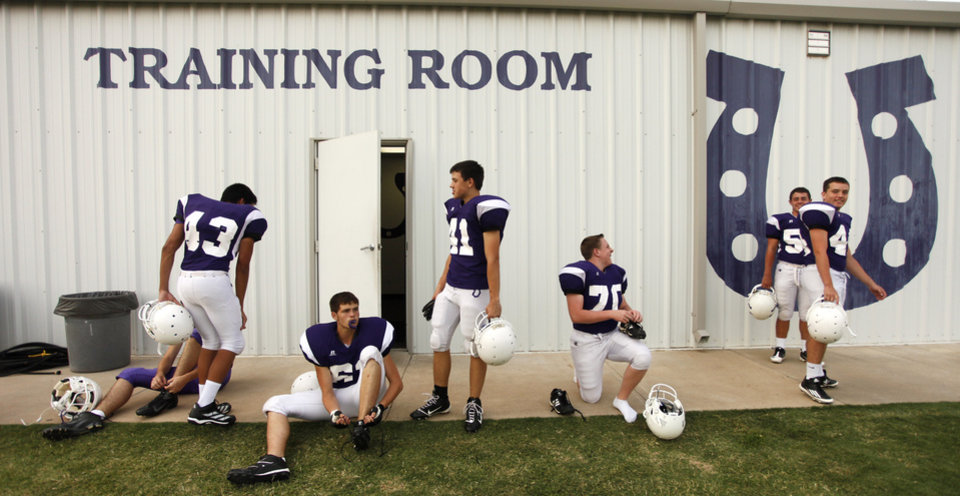 Photo - Bethany players finish suiting up before a high school football scrimmage between Bethany and Jones at Bethany Bronco Stadium, Thursday, August 22, 2012. Photo by Doug Hoke, The Oklahoman.