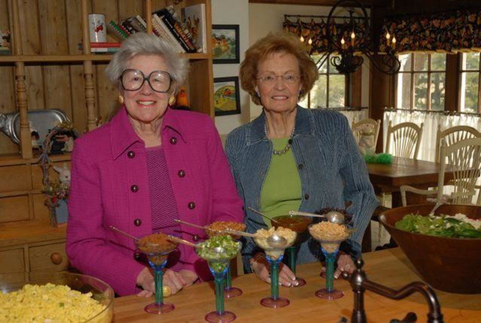 MARCH BIRTHDAYS....Lettie Douglass and Priscilla Braun, two of the hostesses for the March birthday party get the food ready for the luncheon. ( Photo by Jerry Hymer).