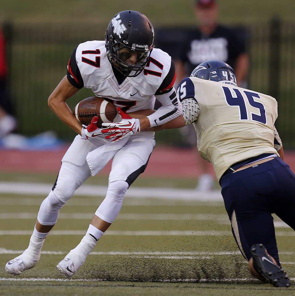 Photo - Westmoore's Jake Dyer tries to get past Southmoore's Keaton Bell during their high school football game in Moore, Okla., Friday, Sept. 13, 2013. Photo by Bryan Terry, The Oklahoman