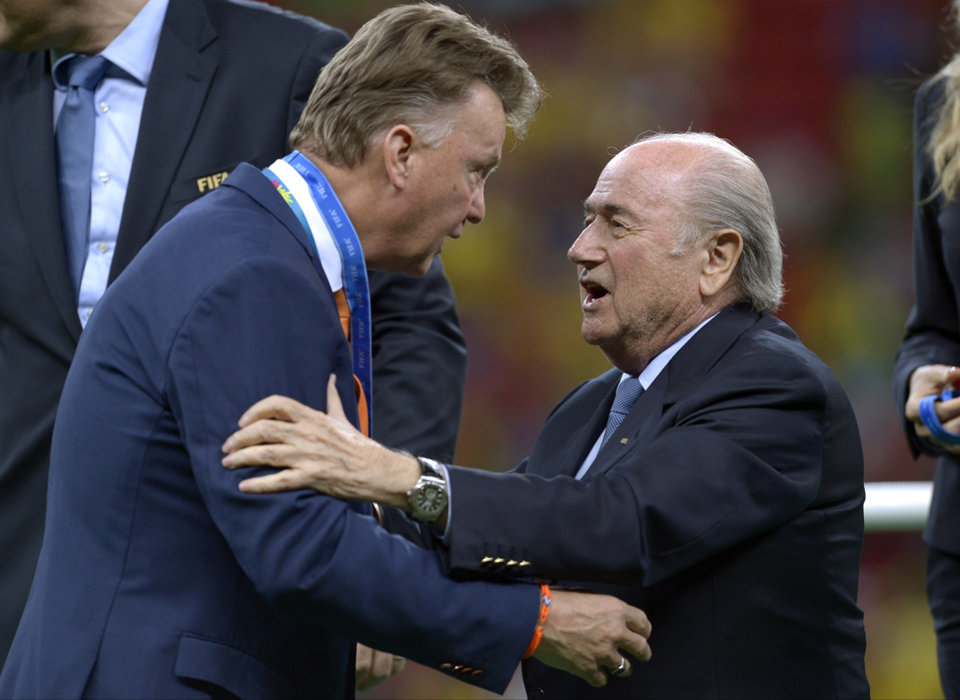 Photo - FIFA President Sepp Blatter, right, presents Netherlands' head coach Louis van Gaal with his 3rd place medal after the World Cup third-place soccer match between Brazil and the Netherlands at the Estadio Nacional in Brasilia, Brazil, Saturday, July 12, 2014. The Netherlands won the match 3-0. (AP Photo/Manu Fernandez)