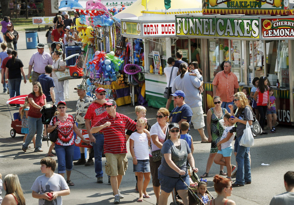 Visitors at the Oklahoma State Fair on Saturday, Sep. 22, 2012.  Photo by Jim Beckel, The Oklahoman.