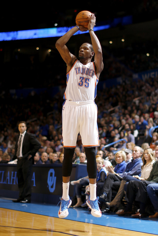 Oklahoma City's Kevin Durant (35) shoots a three pointer during an NBA basketball game between the Oklahoma City Thunder and The Milwaukee Bucks at Chesapeake Enerdy Arena in Oklahoma City, Saturday, Jan. 11, 2014.  Photo by Bryan Terry, The Oklahoman