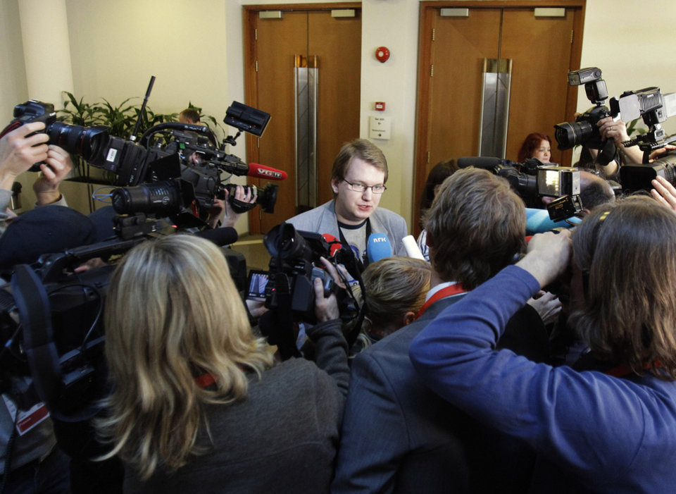 Utoya shooting survivor Tore Sinding Bekkedal, center, speaks to the media in front of the courtroom where Anders Behring Breivik is appearing on terror and murder charges, Oslo, Norway, Monday, April 16, 2012. Breivik, who admitted to killing 77 people in Norway, has pleaded not guilty in court to terror and murder charges saying he was acting in self-defense.(AP Photo/Frank Augstein)