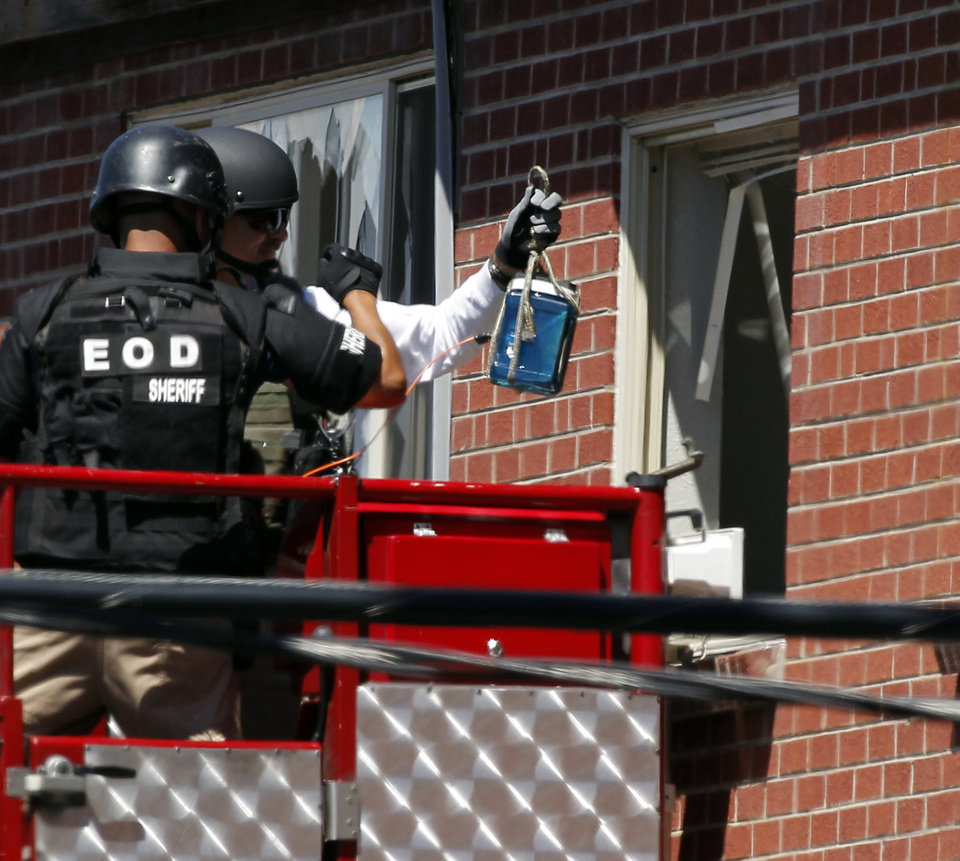 Photo -   Members of law enforcement wearing body armor and helmets prepare to what ATF sources describe as a
