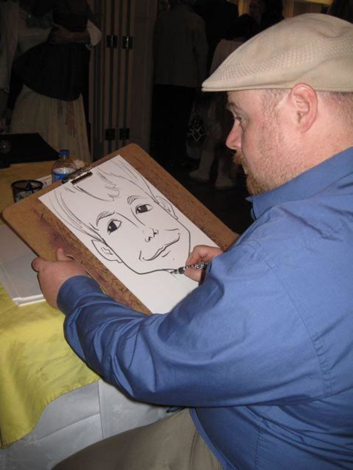 EASTER EGG HUNT.... Caricature artist, Cary Stringfield, draws  pictures for the guests at the party. (Photo by Helen Ford Wallace).