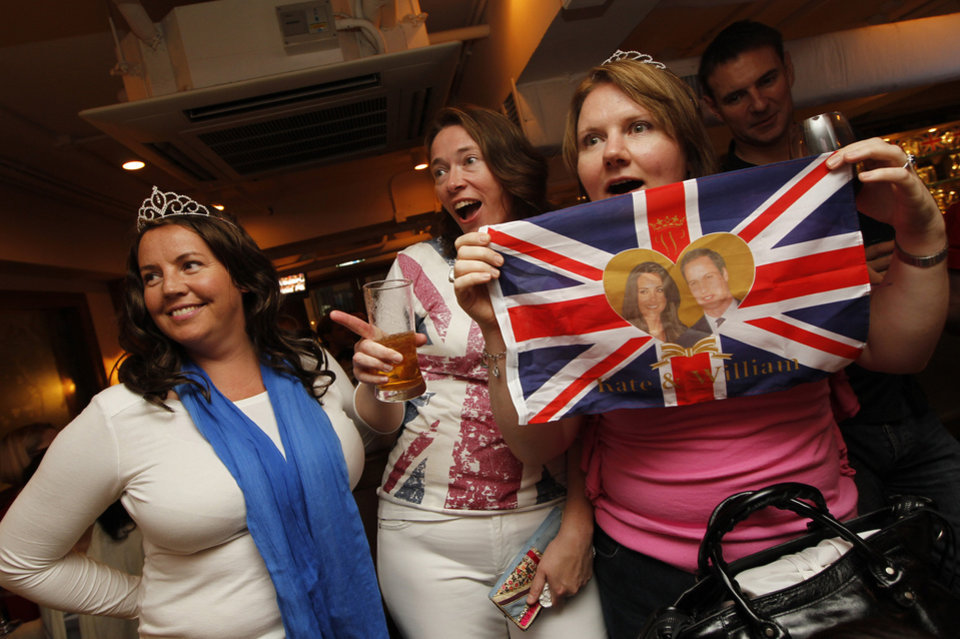 Photo - British expatriates in Hong Kong watch the Royal Wedding of Prince William and Kate Middleton on TV during a party at a pub in the former British colony on Friday, April 29, 2011. (AP Photo/Vincent Yu) ORG XMIT: XVY101
