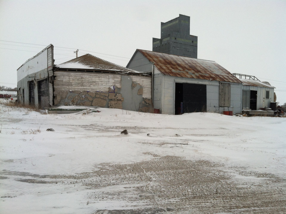 Photo - This photo taken on March 3, 2014, and provided by the North Dakota Health Department, shows the exterior of an abandoned building in Noonan, North Dakota, where bags full of radioactive oil filter socks, the nets that strain liquids during the oil production process, were found.  State Waste Management Director Scott Radig said the hundreds of the tubular filters discovered last week in the abandoned building is likely to be more than twice as large as the state's next-largest dumping incident found last month in McKenzie County.  (AP Photo/North Dakota Health Department)