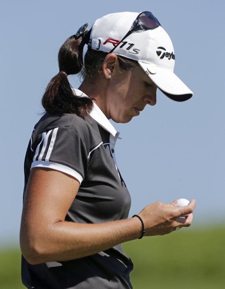 Photo -   Nicole Castrale studies her ball on the first green during final round play in the Navistar LPGA Classic golf tournament on Sunday, Sept. 23, 2012, at the Robert Trent Jones Golf Trail in Prattville, Ala. (AP Photo/Dave Martin)