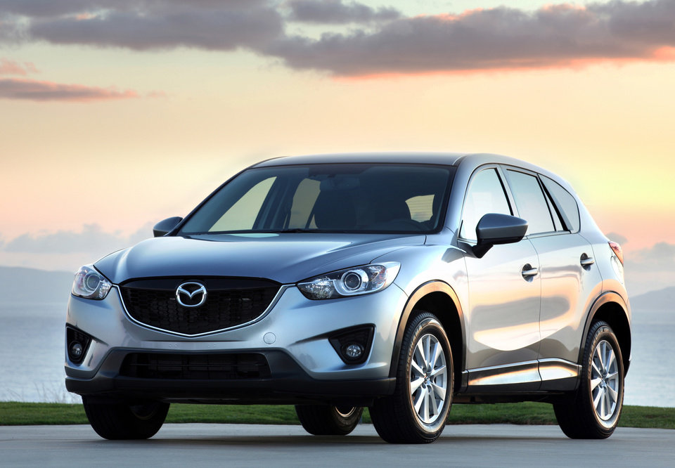 Photo - This undated image made available by Mazda shows the 2014 CX-5 compact sport utility vehicle. (AP Photo/Mazda)