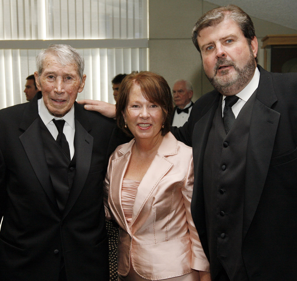 From left, Cal McLish, Jill Weigel and Jim Weigel pose for a photo before the Oklahoma Sports Hall of Fame induction ceremony at the National Cowboy & Western Heritage Museum, Monday, August 3, 2009. By Nate Billings, The Oklahoman