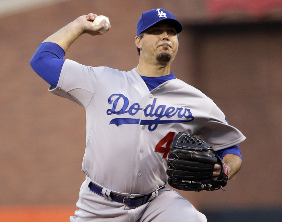 Photo - Los Angeles Dodgers starting pitcher Josh Beckett throws to the San Francisco Giants during the first inning of a baseball game Tuesday, April 15, 2014, in San Francisco. (AP Photo/Marcio Jose Sanchez)