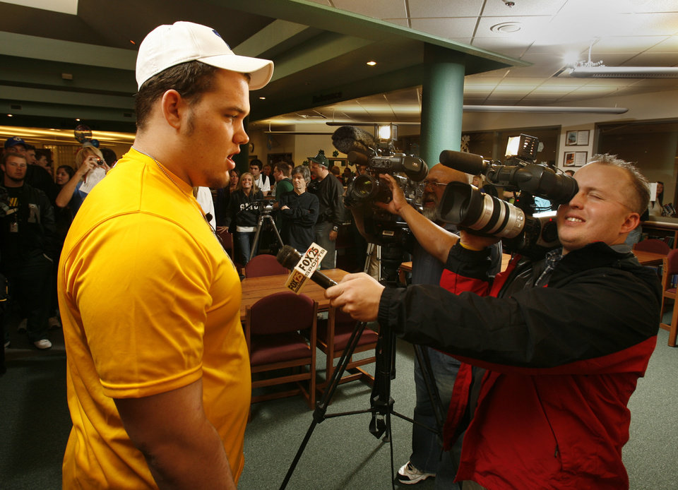 Photo - Cody Hughes talks with the media after signing a letter of intent to play college football at Norman North High School in Norman, Okla. on Wednesday, Feb. 4, 2009.    Photo by Steve Sisney, The Oklahoman