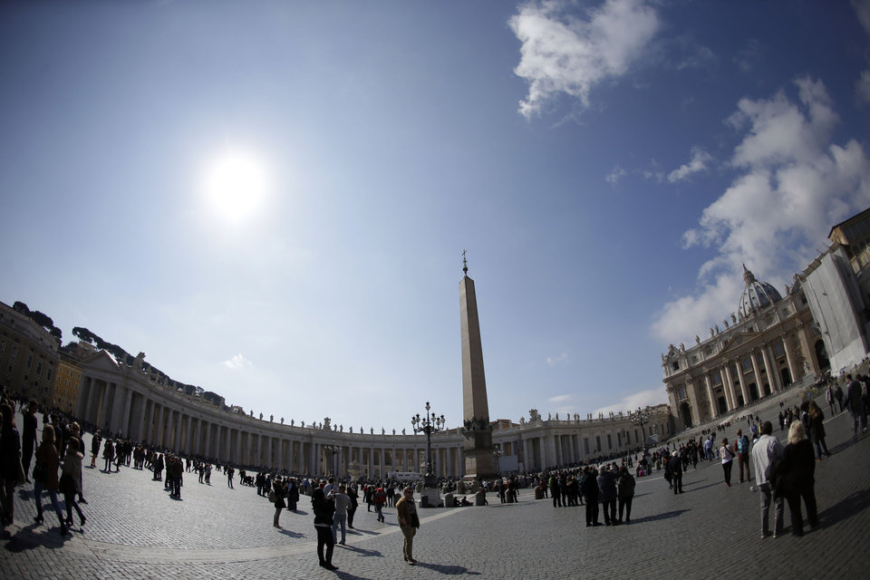 "In this photo taken with a fisheye lens people walk in St. Peter's Square at the Vatican, Sunday, March 3, 2013. Benedict XVI's 8 p.m. resignation Thursday, Feb. 28, opened what is known as the ""sede vacante'' or ""vacant see'', the transition period between papacies when a few key Vatican officials take charge of running the church. (AP Photo/Andrew Medichini)"