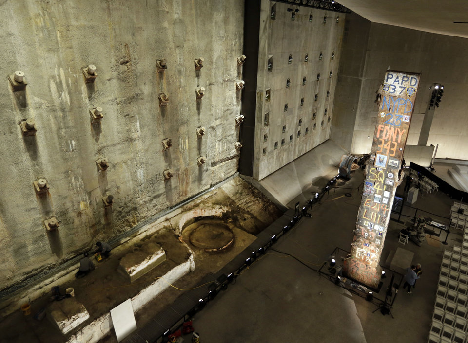 Photo - A portion of the World Trade Center slurry wall, left, and the symbolic last beam, are displayed at the National Sept. 11 Memorial Museum, Wednesday, May 14, 2014, in New York. The museum is a monument to how the Sept. 11 terror attacks shaped history, from its heart-wrenching artifacts to the underground space that houses them amid the remnants of the fallen twin towers' foundations. It also reflects the complexity of crafting a public understanding of the terrorist attacks and reconceiving ground zero.  (AP Photo)