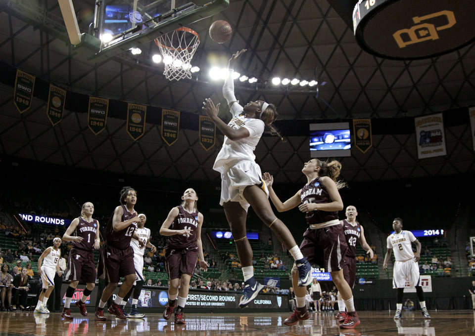 Photo - California's Reshanda Gray (21) goes up for a shot as Fordham's Erin Rooney (1), Mary Nwachukwu (12), Emily Tapio (11) and Hannah Missry, right, watch during the first half of a first-round game in the NCAA women's college basketball tournament, Saturday, March 22, 2014, in Waco, Texas. (AP Photo/Tony Gutierrez)