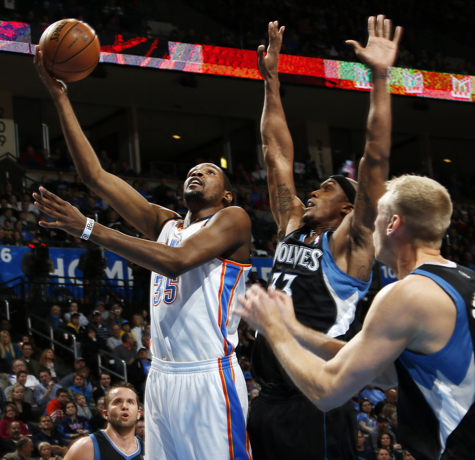 Oklahoma City\'s Kevin Durant (35) lays up a shot past Minnesota\'s Dante Cunningham (33) and Greg Stiemsma (34) during an NBA basketball game between the Oklahoma City Thunder and Minnesota Timberwolves at Chesapeake Energy Arena in Oklahoma City, Friday, Feb. 22, 2013. Photo by Nate Billings, The Oklahoman