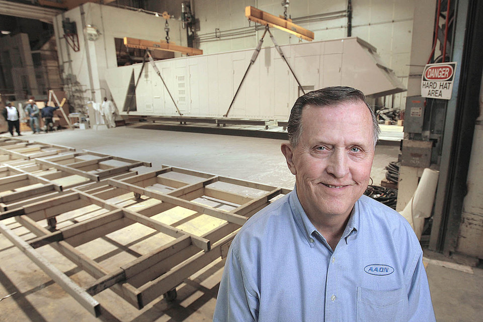 Norm Asbjornson, president and chief executive officer of AAON, in a fabrication bay with aclimate control unit in Tulsa. PHOTO BY MICHAEL WYKE, Tulsa World