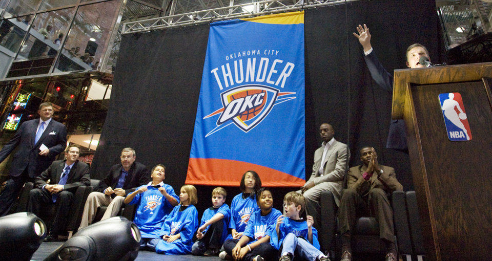 Photo - From left, team chairman Clay Bennett, general manager Sam Presti, head coach PJ Carlesimo, various children, players Damien Wilkins and Desmond Mason watch Matt Pinto speak during the unveiling of the Oklahoma City Thunder NBA team name at Leadership Square in downtown Oklahoma City, Wednesday, September 3, 2008. NATE BILLINGS, THE OKLAHOMAN