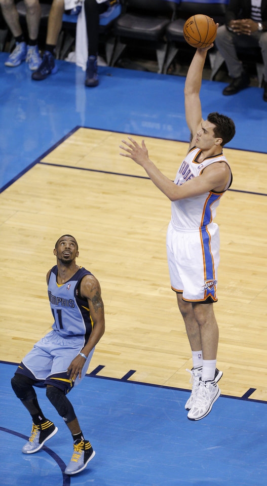 Photo - Oklahoma City's Steven Adams (12) shoots over Memphis' Mike Conley (11) during Game 7 in the first round of the NBA playoffs between the Oklahoma City Thunder and the Memphis Grizzlies at Chesapeake Energy Arena in Oklahoma City, Saturday, May 3, 2014. Photo by Sarah Phipps, The Oklahoman
