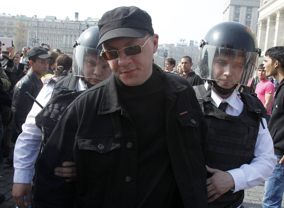 Police detain a member of the Left Front movement in downtown Moscow, Russia, Wednesday, May 9, 2012. The cat-and-mouse game between protesters and police began on Monday, the day of Putin's inauguration at a formal ceremony inside the Kremlin. Hundreds of activists tried to protest near Red Square and along the route Putin's motorcade took to the Kremlin, but they were turned back or detained by thousands of riot police. (AP Photo/Misha Japaridze)
