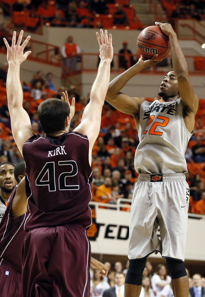 Photo - OSU's Markel Brown (22) shoots against Christian Kirk (42) of Missouri State during a men's college basketball between Oklahoma State University and Missouri State at Gallagher-Iba Arena in Stillwater, Okla., Saturday, Dec. 8, 2012. Photo by Nate Billings, The Oklahoman