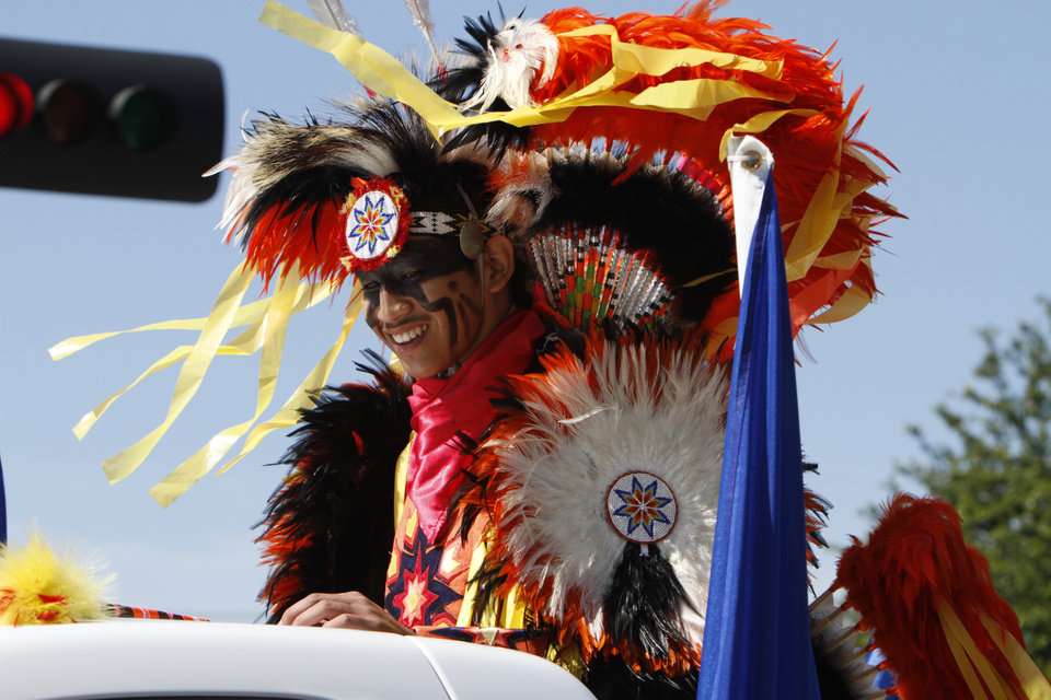 A member of the Comanche nation rides on the back of a pick up truck through downtown Oklahoma City during the Red Earth parade on Friday, June 7, 2013. Photo by Aliki Dyer, The Oklahoman