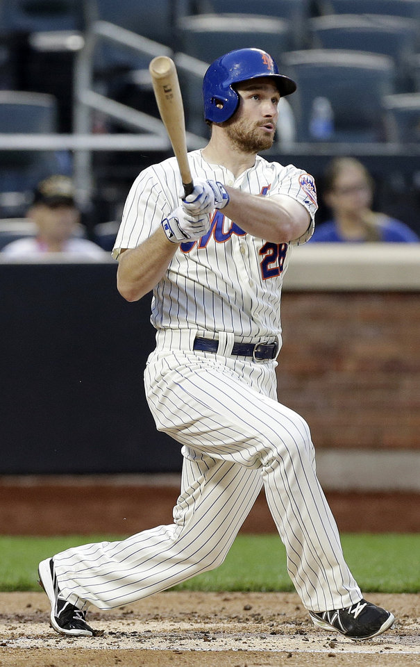 Photo - New York Mets' Daniel Murphy follows through on a two-run home run during the third inning of a baseball game against the Milwaukee Brewers, Tuesday, June 10, 2014, in New York. (AP Photo/Frank Franklin II)