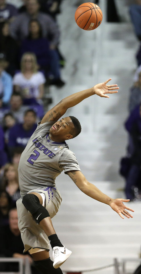 Photo - Kansas State's Marcus Foster tries to control the ball after being fouled during the first half of an NCAA college basketball game against Baylor Saturday, March 8, 2014, in Manhattan, Kan. (AP Photo/Charlie Riedel)