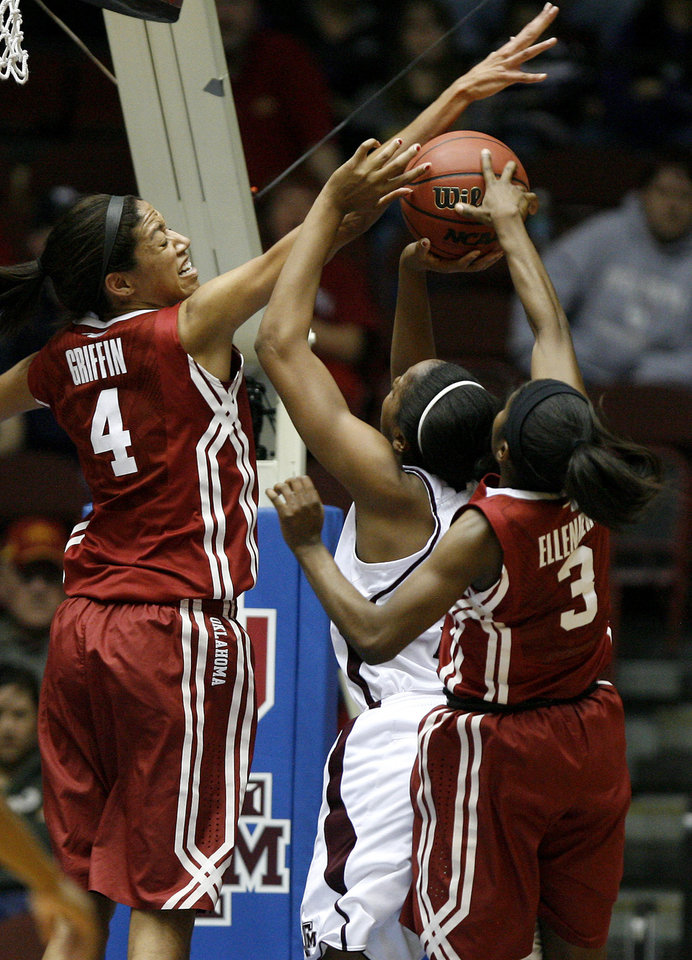 OU's Nicole Griffin (4) and Aaryn Ellenberg (3) defend Texas A&M's Adaora Elonu (21) during the women's college basketball Big 12 Championship tournament game between the University of Oklahoma and Texas A&M in Kansas City, Mo., Friday, March 11, 2011.  Photo by Bryan Terry, The Oklahoman