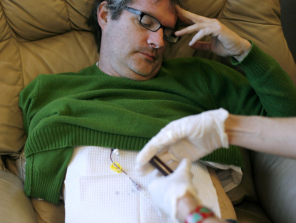 Photo - CANCER PATIENT: Jim Chastain watches a nurse begin his chemotherapy treatment at OU Physicians Hospital in Oklahoma City on Dec 1, 2008.  By John Clanton, The Oklahoman  ORG XMIT: KOD