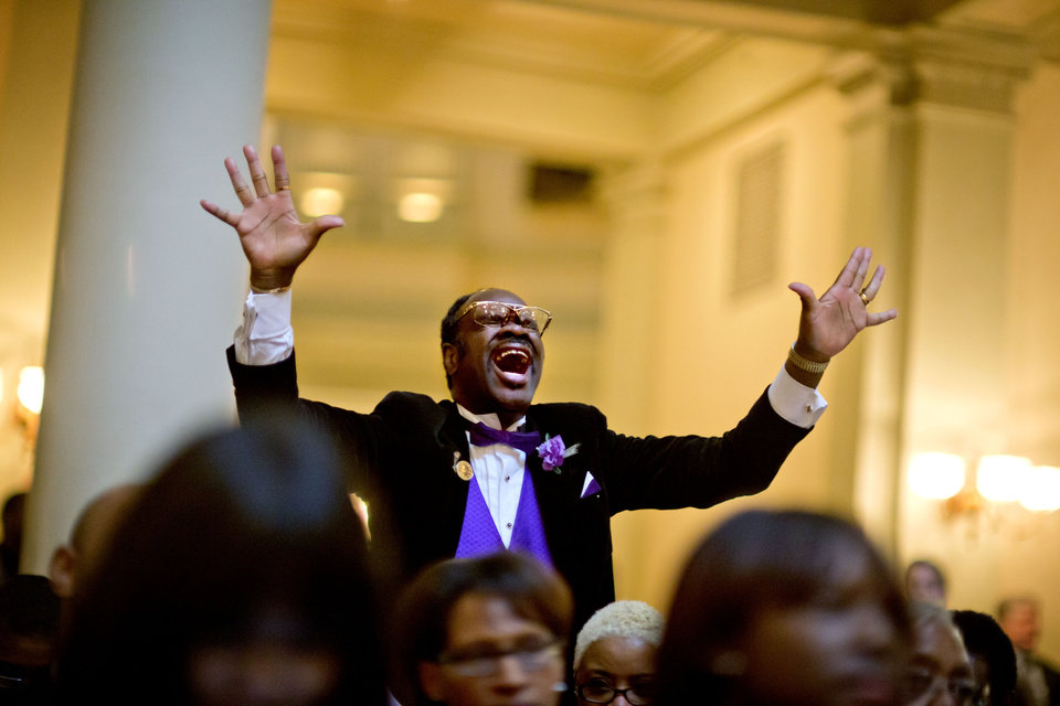 "Elder Cal Murrell, also known as ""the happy preacher,"" reacts during a service celebrating the Rev. Martin Luther King Jr., inside the State Capitol, Thursday, Jan. 17, 2013, in Atlanta. (AP Photo/David Goldman)"