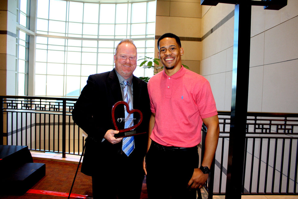 Brandon Hall, of Tuttle, left, performed CPR on Norman Richards, 22, of Del City, right, after Richards was shot near the Bricktown Ballpark after the fifth game of the NBA playoff series between the Los Angeles Lakers and the Oklahoma City Thunder. Hall was honored Friday by the Oklahoma Heart Hospital. PHOTO PROVIDED BY OKLAHOMA HEART HOSPITAL <strong></strong>