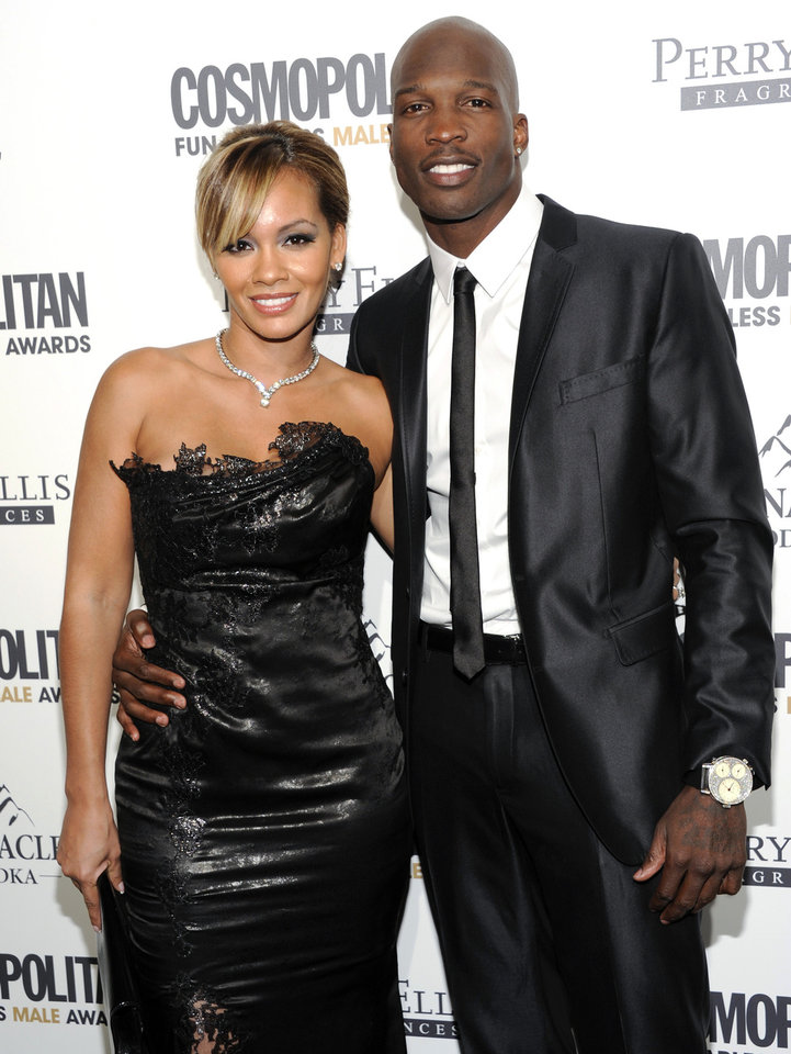 Photo -   FILE - In this March 7, 2012, file photo, NFL football player Chad Johnson, right, poses with his fiancee, Evelyn Lozada, at an event in New York. Johnson was arrested Saturday, Aug. 11, 2012, on a domestic violence charge, accused of head-butting Lozada during an argument in front of their home outside Miami. Johnson and Lozada, now married, were at dinner and she confronted him about a receipt she had found for a box of condoms, said Davie police Capt. Dale Engle. The argument got heated and continued on the drive home, he said. (AP Photo/Evan Agostini, File)