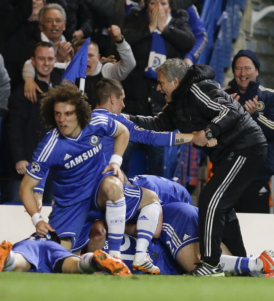 Photo - Chelsea's manager Jose Mourinho, right, celebrates with his team after Demba Ba scores the winning goal during the Champions League second leg quarterfinal soccer match between Chelsea and Paris Saint-Germain at Stamford Bridge Stadium in London, Tuesday, April 8, 2014. (AP Photo/Kirsty Wigglesworth)