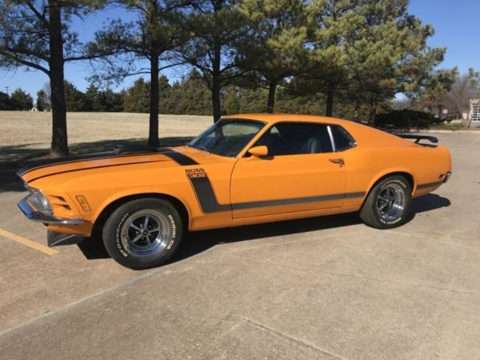 Photo -  This 1970 Mustang Boss 302 that was seized in a 2016 raid on a car cloning operation is one of the cars scheduled to be auctioned off Feb. 8 at FireLake Arena in Shawnee.