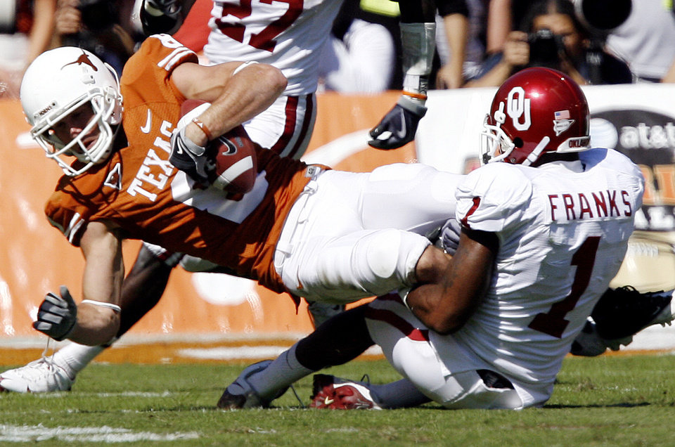 Photo - Oklahoma's Dominique Franks (1) brings down Texas' Jordan Shipley (8) after a reception during the Red River Rivalry college football game between the University of Oklahoma Sooners (OU) and the University of Texas Longhorns (UT) at the Cotton Bowl in Dallas, Texas, Saturday, Oct. 17, 2009. Photo by Chris Landsberger, The Oklahoman