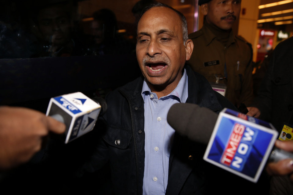 Photo - Uttam Khobragade, father of Devyani Khobragade, who served as India's deputy consul general in New York, talks to press after meeting his daughter after her arrival at the Indira Gandhi International airport in New Delhi, India, Friday, Jan. 10, 2014. Devyani Khobragade was allowed to fly home to India on Friday after being indicted by a U.S. federal grand jury. In retaliation to the diplomatic dispute touched off by the arrest and strip search of Khobragade in New York, India has asked the United States on Friday to withdraw a diplomat from the U.S. Embassy in New Delhi. (AP Photo/Saurabh Das)