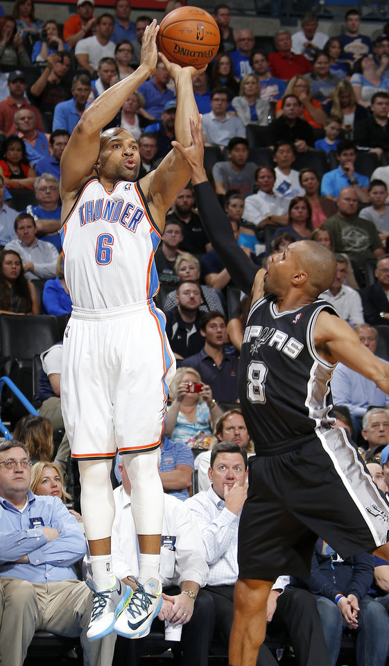Photo - Oklahoma City's Derek Fisher (6) is fouled by San Antonio's Patty Mills (8) during an NBA basketball game between the Oklahoma City Thunder and the San Antonio Spurs at Chesapeake Energy Arena in Oklahoma City, Thursday, April 3, 2014. Oklahoma City won 106-94. Photo by Bryan Terry, The Oklahoman