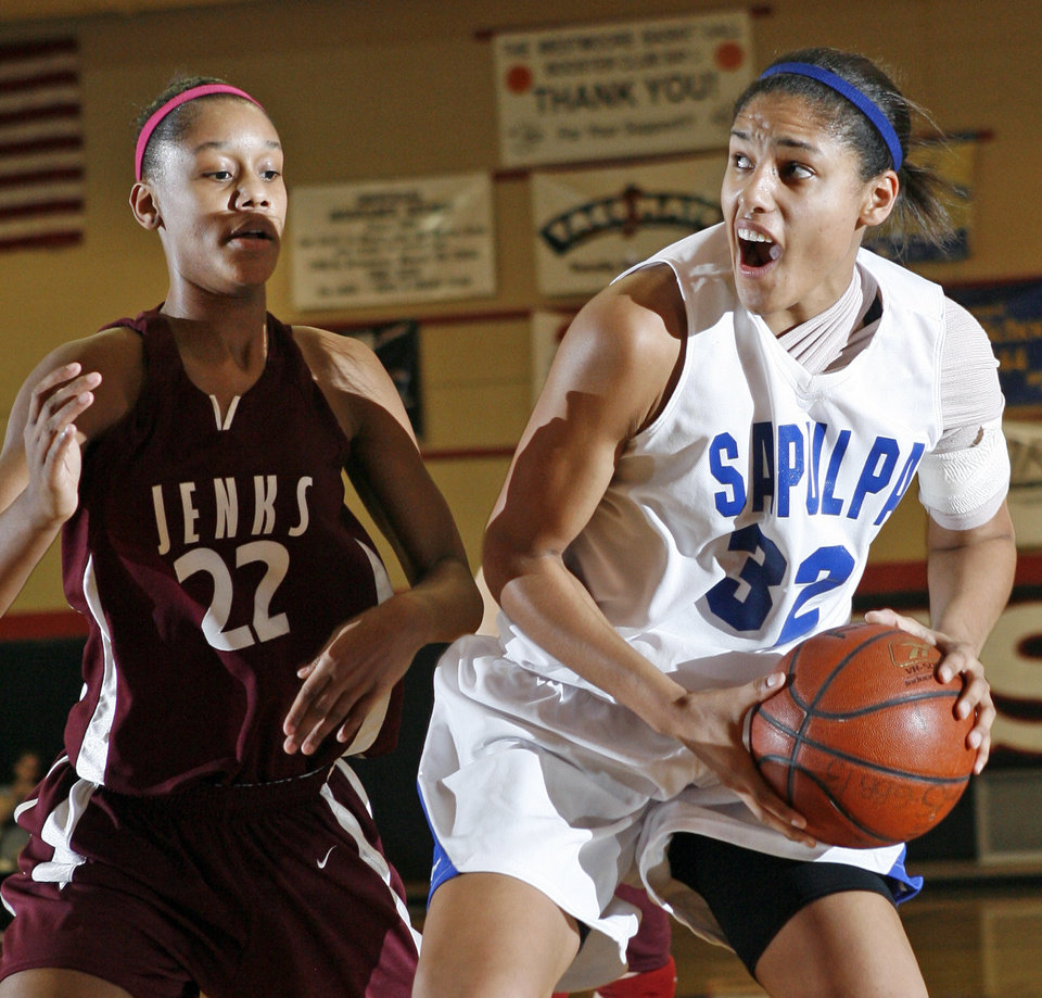 Photo - Sapulpa's Alyssia Brewer (32) tries to move to the hoop around Latia Magee  (22) of Jenks during the girls high school basketball game between Jenks and Sapulpa at Westmoore High School in Oklahoma City, Friday, January 11, 2008. Sapulpa won, 62-45. BY NATE BILLINGS, THE OKLAHOMAN ORG XMIT: KOD