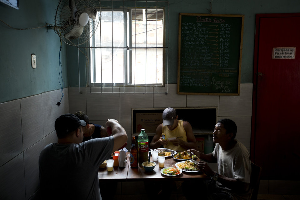 Photo - In this May 22, 2013 photo, customers eat lunch at Restaurante 48 in the Tabajaras slum in Rio de Janeiro, Brazil. The pacified favelas are the newest hotspots for both locals and foreign visitors, including a number of bars and restaurants. (AP Photo/Victor R. Caivano)