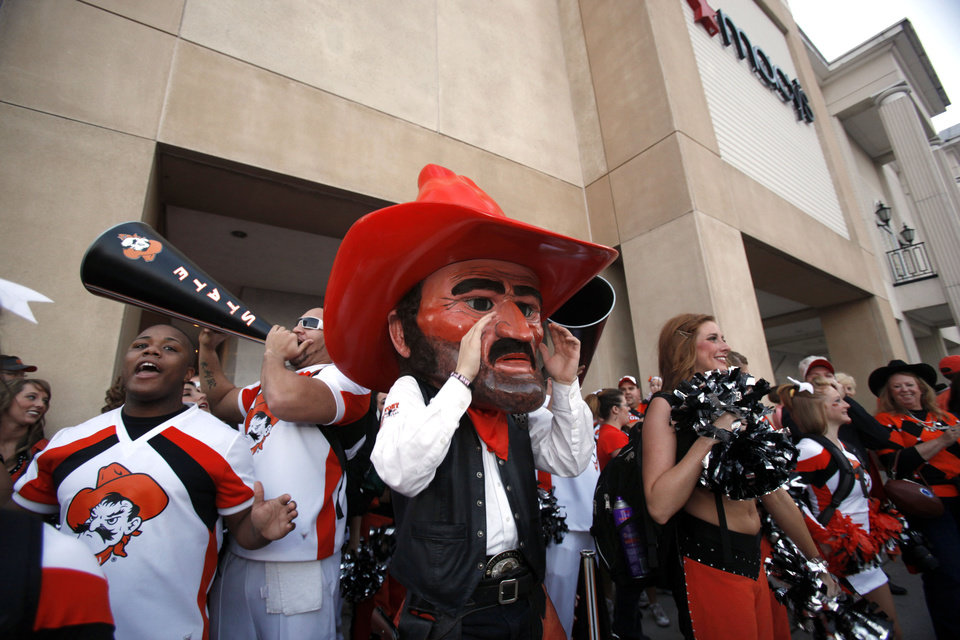 Photo - Pistol Pete cheers during the Spirit Walk before the Valero Alamo Bowl college football game between the Oklahoma State University Cowboys (OSU) and the University of Arizona Wildcats  at the Alamodome in San Antonio, Texas, Wednesday, December 29, 2010. Photo by Sarah Phipps, The Oklahoman