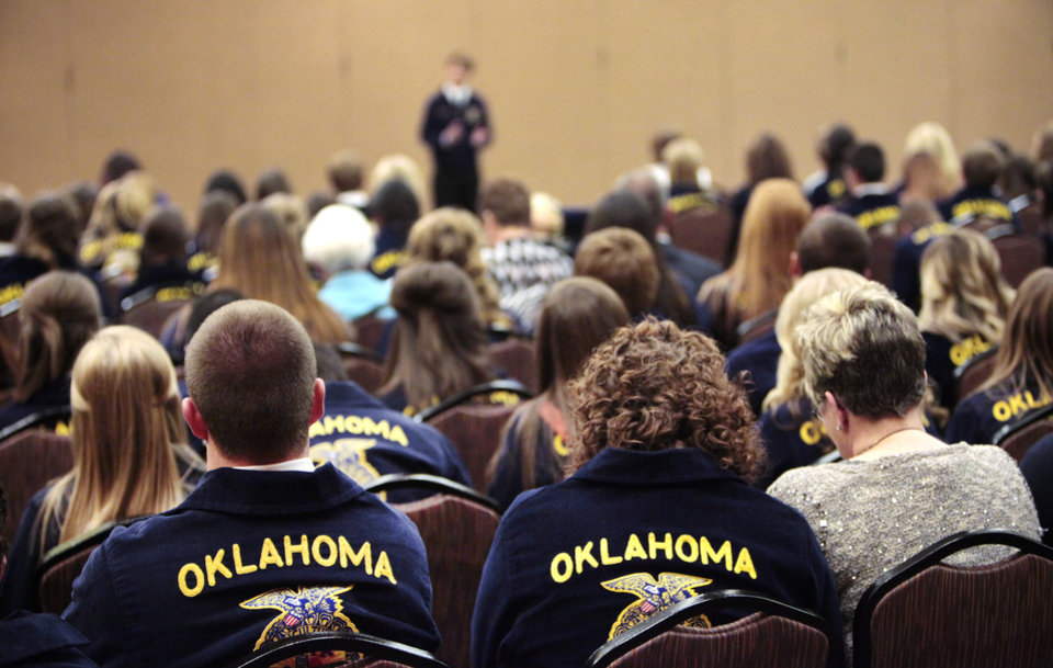 Photo -  A crowd listens to Braden Hague, of Edmond, during the public speaking competition on Tuesday at the state FFA convention. Photo by David McDaniel, The Oklahoman   David McDaniel -