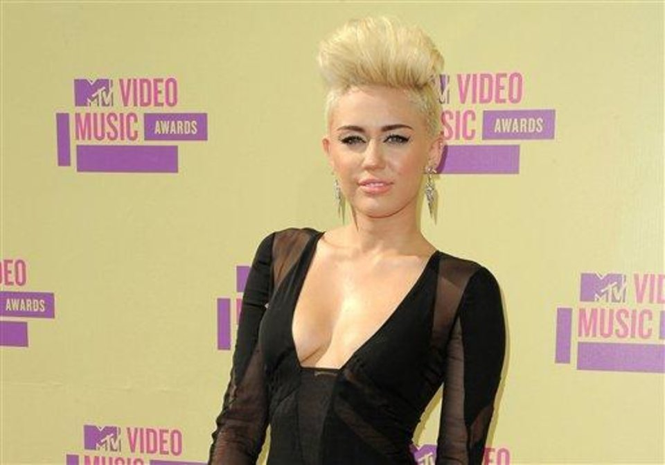 Photo - FILE - In this Sept. 6, 2012 file photo, Miley Cyrus attends the MTV Video Music Awards in Los Angeles. When Cyrus cut off the long hair her fans had become used to, she took some heat. She has said (and Tweeted) repeatedly, though, that she was pleased with the new punk-pixie look and was sticking with it.  (Photo by Jordan Strauss/Invision/AP, file)